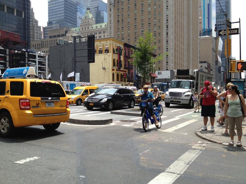 Taxis, pedestrians, and Citi Bikers: the usual Manhattan street melange.