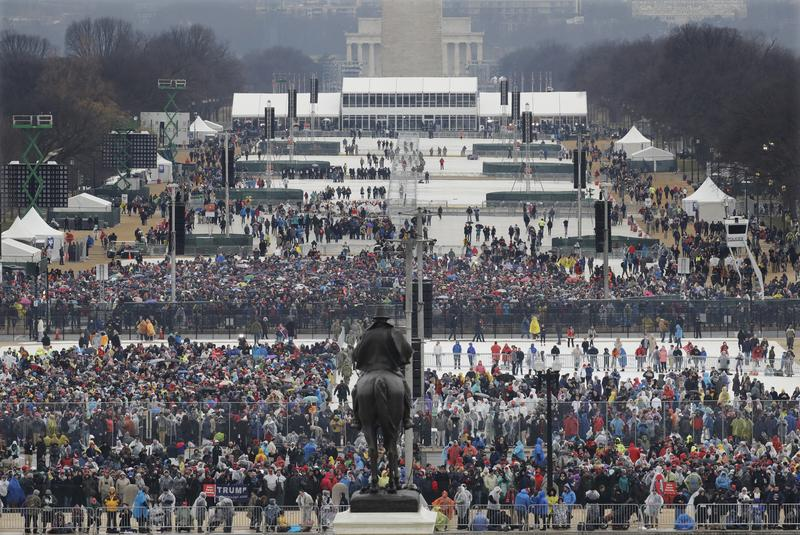 Crowds fill in along the National Mall before the swearing in of Donald Trump as the 45th president of the Untied States during the 58th Presidential Inauguration at the U.S. Capitol in Washington.