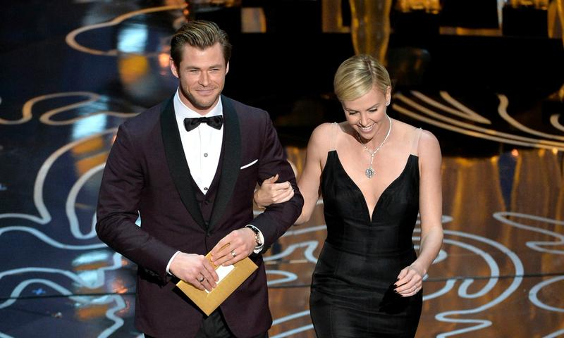 Chris Hemsworth and Charlize Theron were co-presenters at the Oscar Awards in March 2014
