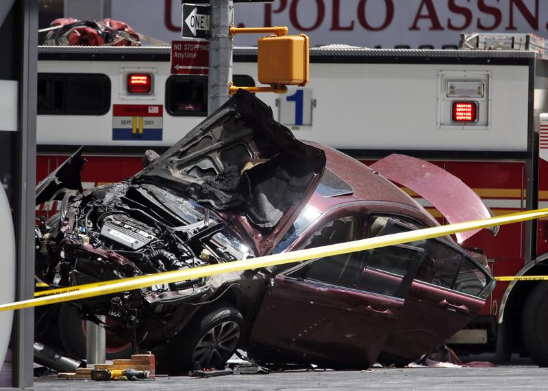 A smashed car sits on the corner of Broadway and 45th Street in New York's Times Square after ploughing through a crowd of pedestrians at lunchtime on Thursday, May 18, 2017.