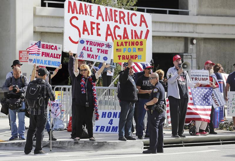 Demonstrators who supported President Donald Trump's initial executive orders barring entry to the U.S. by travelers from seven Muslim-majority countries cheered at LAX in February.