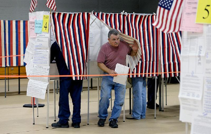ACO, ME - NOVEMBER 3: Scott LaBreck exits the voting booth after voting at the Saco Community Center where voter turnout was described as steady by a poll worker Tuesday, November 3, 2015