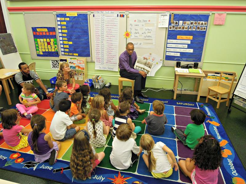 Schools Chancellor Dennis Walcott reads to kindergarten students at the Peck Slip School before announcing changes to the city's kindergarten application process.