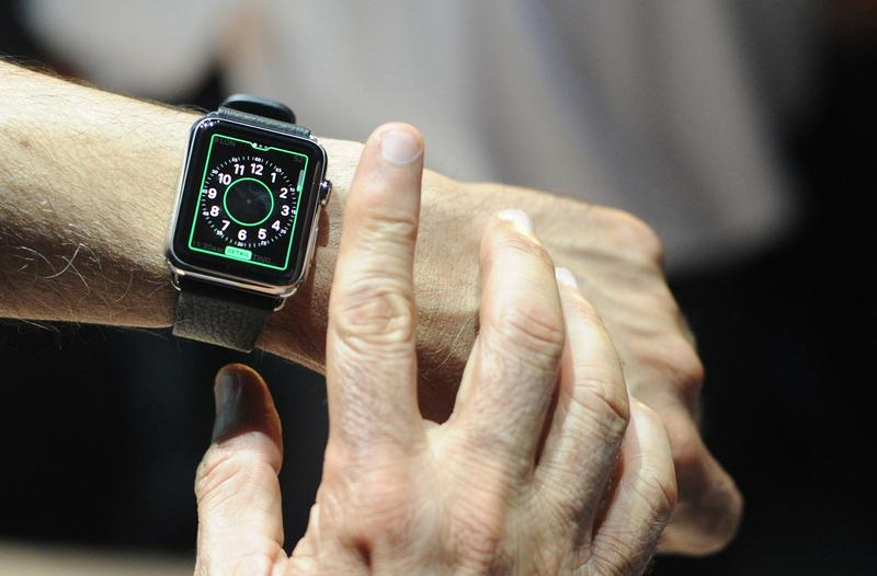 An Apple employee demonstrates how to use an Apple Watch during an Apple media event at the Yerba Buena Center for the Arts in San Francisco, California on March 09, 2015.