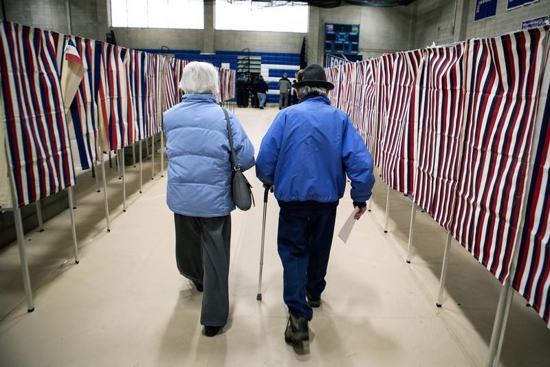 Voters cast their ballots at Merrimack High School on primary day, February 9, 2016, in Merrimack, New Hampshire.