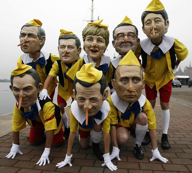 Anti-globalization activists from the group 'Oxfam' have dressed up as the leaders of the Group of Eight including at the harbor in the north-eastern German town of Rostock 05 June 2007.