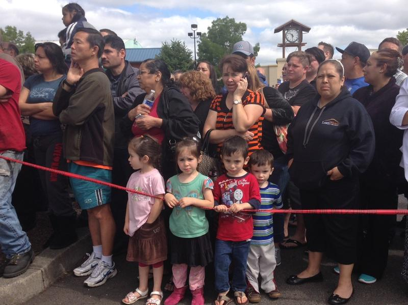 Parents and family members gather at the Cherry Park Safeway in Troutdale, Oregon.