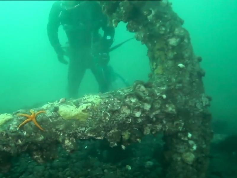 A screen grab from <em>The Seattle Times</em> shows the anchor beofre it was hoisted from the bottom of Puget Sound.
