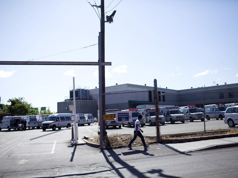 Ambulances fill a parking lot at the DaVita Dialysis Center in Paterson, N.J., on May 31.