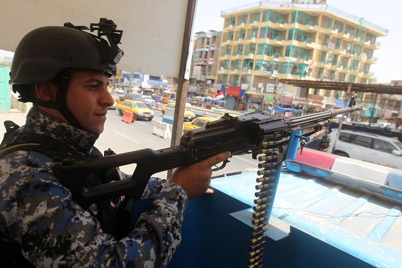 An Iraqi policeman mans a checkpoint in the capital Baghdad on June 12, as jihadists and anti-government fighters have spearheaded a major offensive that overrun all of Nineveh province. Jihadists are pushing toward Baghdad after capturing a town only 56 miles to its north, in a lightning three-day offensive the Iraqi government has failed to stop. (Ahmad Al-Rubaye/AFP/Getty Images)