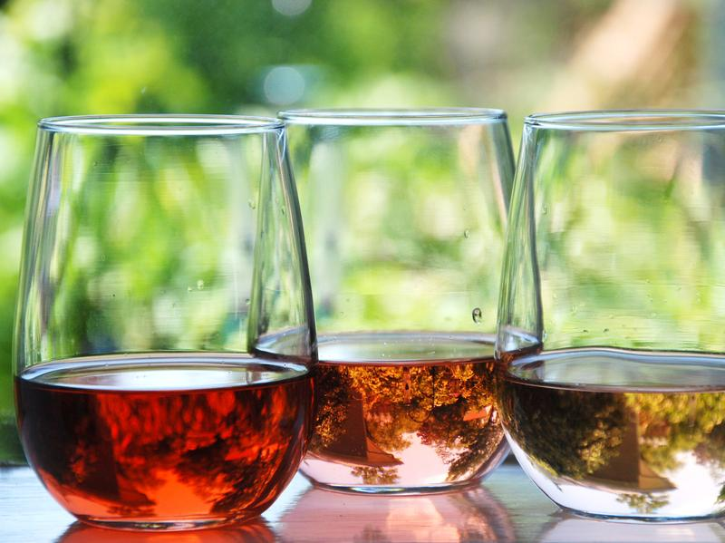 The intensity of pink color in rosé wine comes from the amount of skin contact the grape juice has with the grape skin in the winemaking process. The wine on the left had the longest skin contact.