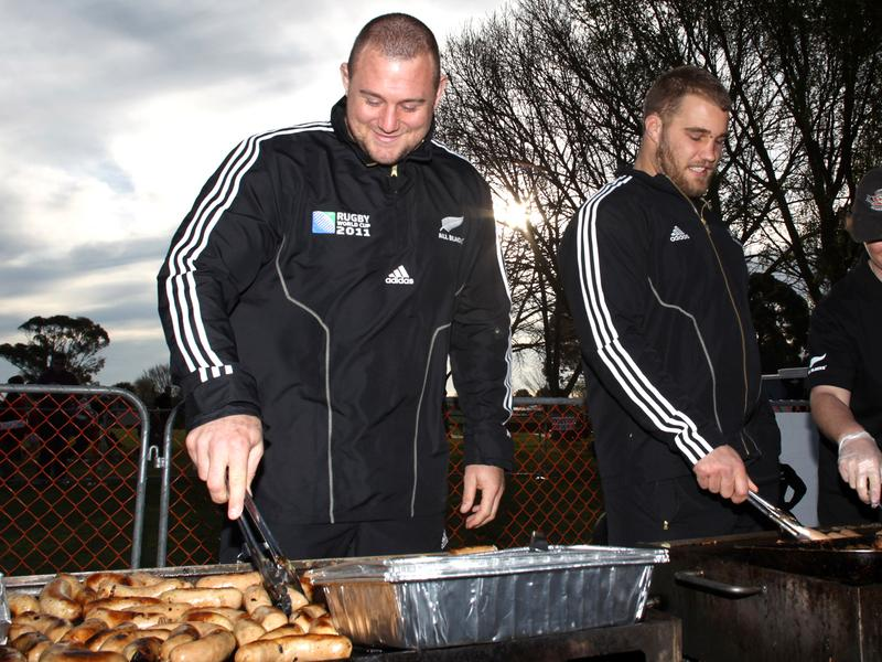 Rugby and meat: a treat for the gut? A study suggests yes. Here Tony Woodcock (Left) and Owen Franks of the All Blacks rugby team turn sausages on the barbeque in 2011 in Christchurch, New Zealand.