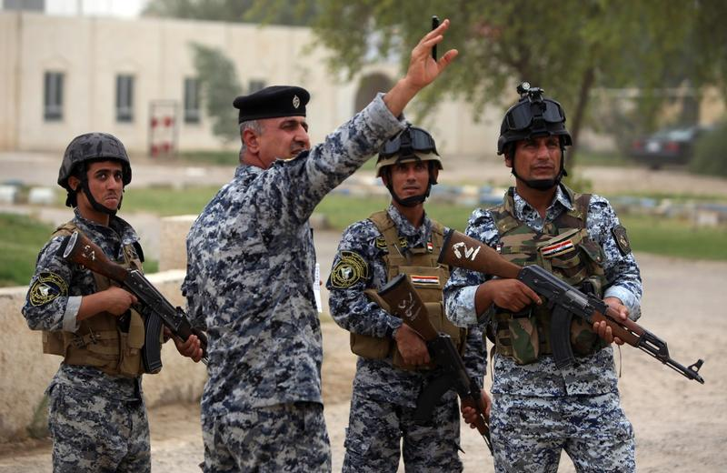 Iraqi policemen are seen on patrol inside a military base in Baghdad, on June 11, 2014, after the parliament had received a joint request from Iraqi Prime Minister Nuri al-Maliki and the president's office to declare a state of emergency. (Ahmad al-Rubaye/AFP/Getty Images)