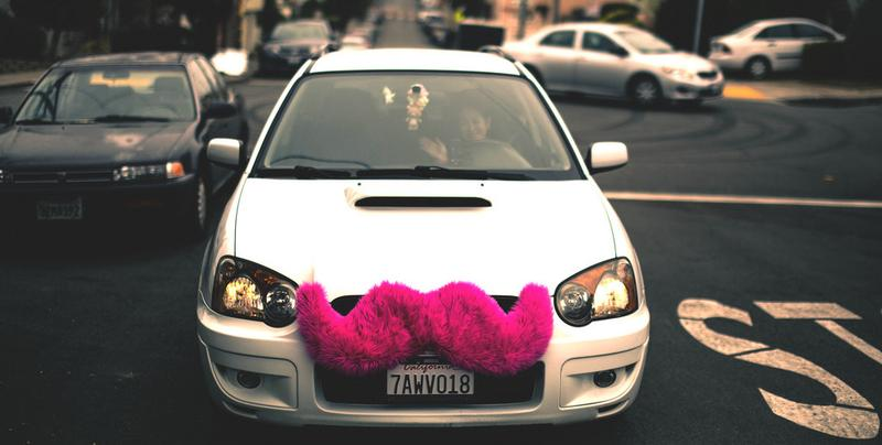 Drivers for Lyft can be identified by the pink, furry mustache on the grill of their cars. (Alfredo Mendez/Flickr)