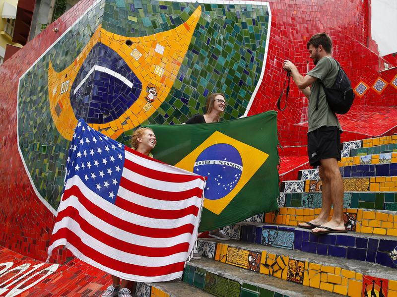 Tourists pose with a U.S. and Brazilian flag ahead of the 2014 World Cup in Rio de Janeiro.