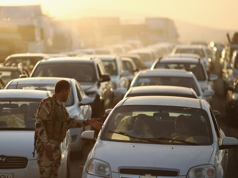 Cars pack a Kurdish checkpoint as residents flee Mosul in northern Iraq. The city was overrun by Islamic militants last week.