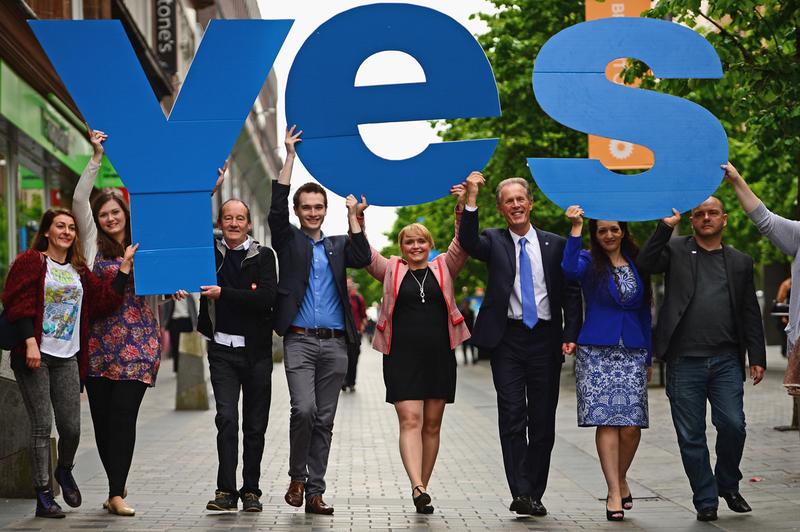 David Hayman and Yes Scotland chief executive Blair Jenkins join members of the Yes Scotland team to mark the start of the regulated referendum period on May 30, 2014, in Glasgow, Scotland. Leading up to the vote on September 18 to determine whether or not Scotland will leave the U.K., there are questions as to what this will mean for Scotland and its people. (Jeff J. Mitchell/Getty Images)