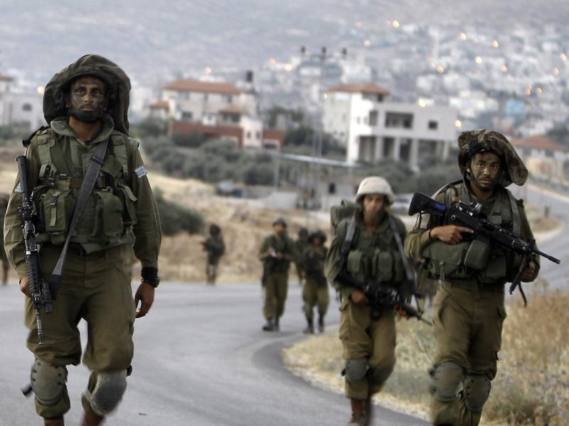 Israeli soldiers patrol in the West Bank village of Beit Furik, near Nablus, on Friday. They are searching for three missing Israeli teenagers believed kidnapped. Israel has detained more than 300 Palestinians in the search over the past week; the military says a majority of them are connected to Hamas.