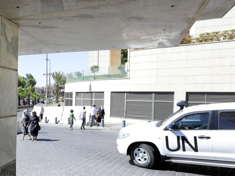 A United Nations vehicle carrying inspectors from the Organization for the Prohibition of Chemical Weapons leaves a hotel in Damascus last fall.