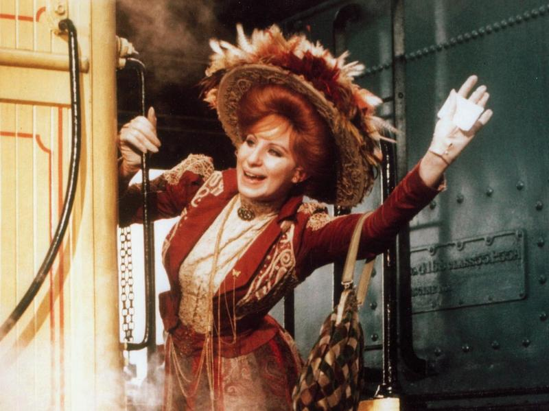 Barbra Streisand does a lot of singing on transit — over the course of <em>Funny Girl, Funny Lady, Yentl</em> and <em>Hello Dolly </em>(above) she sings aboard a train, a plane, a taxi a tugboat, and an ocean liner.