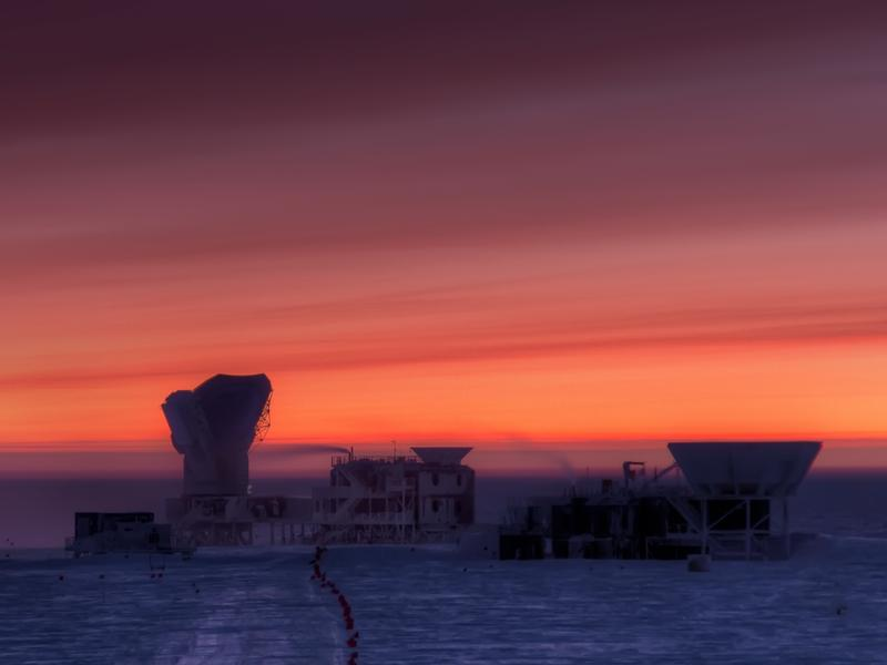 "The sun rises behind the cosmic microwave background (CMB) radiation telescopes at the National Science Foundation'€™s <a href=""http://www.nsf.gov/news/special_reports/livingsouthpole/sciencegoals.jsp"">South Pole Station</a>."