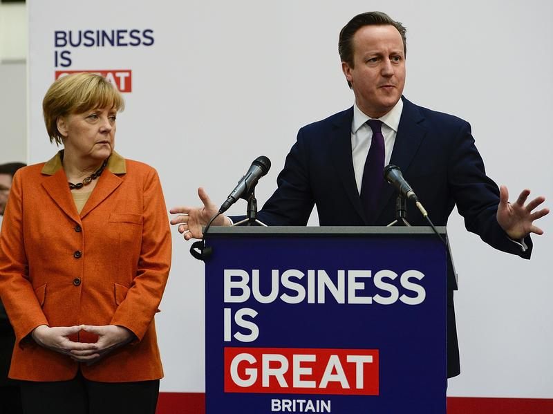 British Prime Minister David Cameron delivers a speech next to German Chancellor Angela Merkel at a technology Trade fair March 10 in Hanover, Germany.