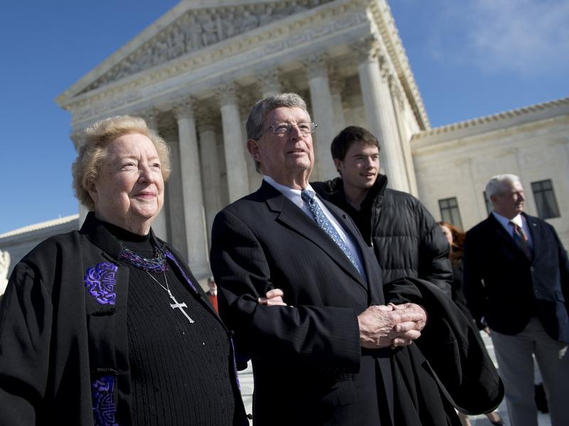 Eleanor McCullen and her attorney, Philip Moran, stand outside the Supreme Court in January after arguments in the case of <em>McCullen v. Coakley</em>.