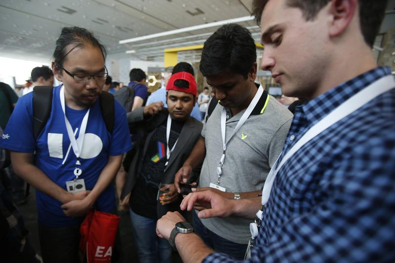 A group of attendees watch a product demonstration of a Motorola Moto 360 watch during the Google I/O Developers Conference at Moscone Center on June 25, 2014 in San Francisco, California. (Stephen Lam/Getty Images)