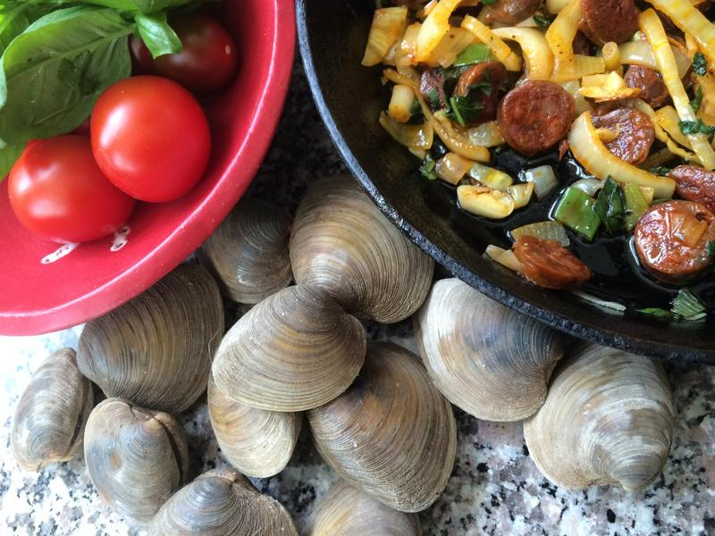 "Kathy Gunst's ""Roast Summer Clams with Chorizo, Tomatoes and Basil."" See recipe below. (Kathy Gunst/Here & Now)"