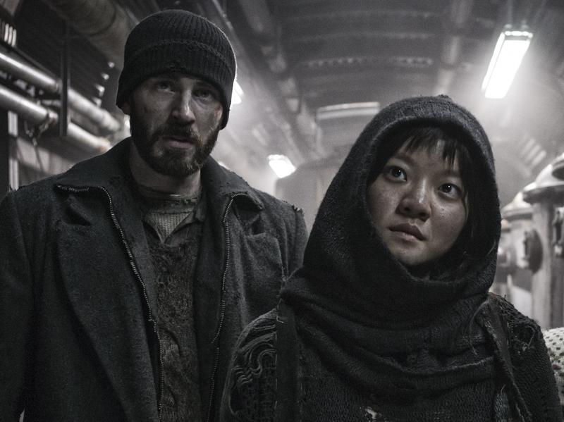 "In <em>Snowpiercer,</em> Curtis (Chris Evans) and Yona (Ah-sung Ko) are trying to fight their way to the front of a train that is cruelly class segregated. ""[It's] similar to Occupy Wall Street in terms of the 99 percent versus the 1 percent,"" says South Korean director Bong Joon-ho. ""That's something that happens in other countries and also in Korea."""