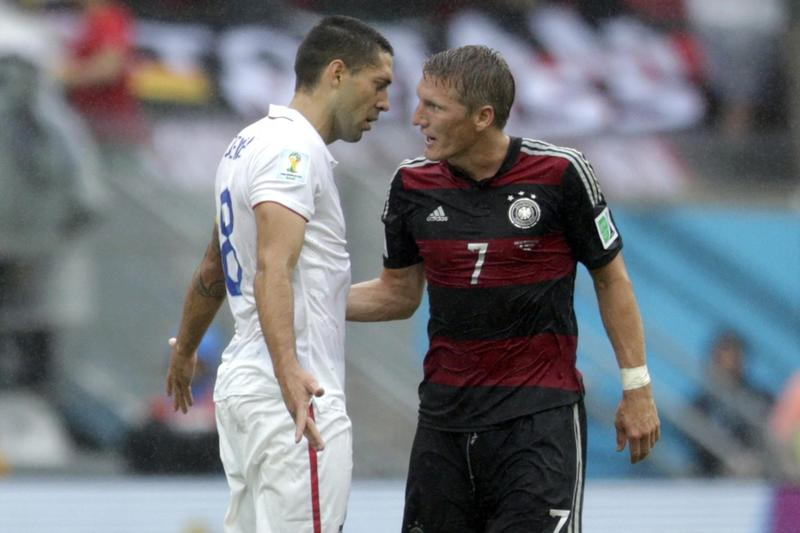 United States' Clint Dempsey argues with Germany's Bastian Schweinsteiger at the half during the group G World Cup soccer match between the United States and Germany at the Arena Pernambuco in Recife, Brazil, Thursday, June 26, 2014. Germany won the game 1-0, but both teams advance out of their competitive group into the next round of the tournament. (AP)