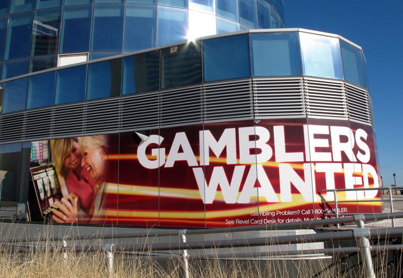 "This Dec. 27, 2013 photo shows a banner outside Revel Casino Hotel in Atlantic City N.J. touting its ""Gamblers Wanted"" promotion to help drum up new business. (Wayne Parry/AP)"