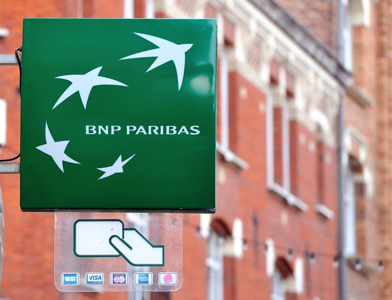 A photo taken on June 24, 2014, in Lille, northern France shows the logo of the French bank BNP Paribas, which is being fined a record $8.9 billion for violating international sanctions.  (Philippe Huguen/AFP/Getty Images)