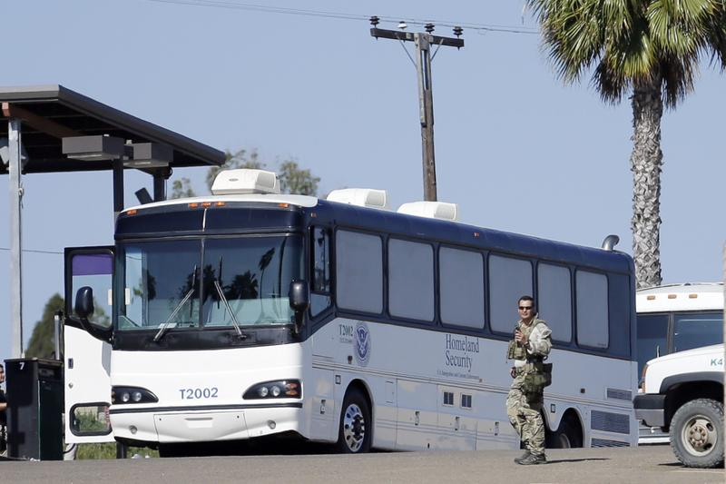 Homeland Security buses that carried migrants sit at a facility near the border with Mexico Tuesday, July 1, 2014, in San Diego. (Gregory Bull/AP)