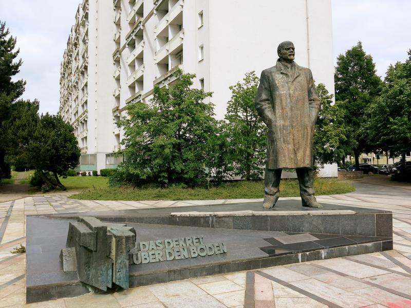 "A statue of Soviet founder Vladimir Lenin outside an apartment complex in Schwerin, Germany. Erected in 1985, four years before communism collapsed in East Germany, it's believed to be the last Lenin statue in Germany and the town is divided over whether it should stay. The inscription reads, ""Decree on land,"" referring to a Lenin manifesto that said workers were the real owners of the land."