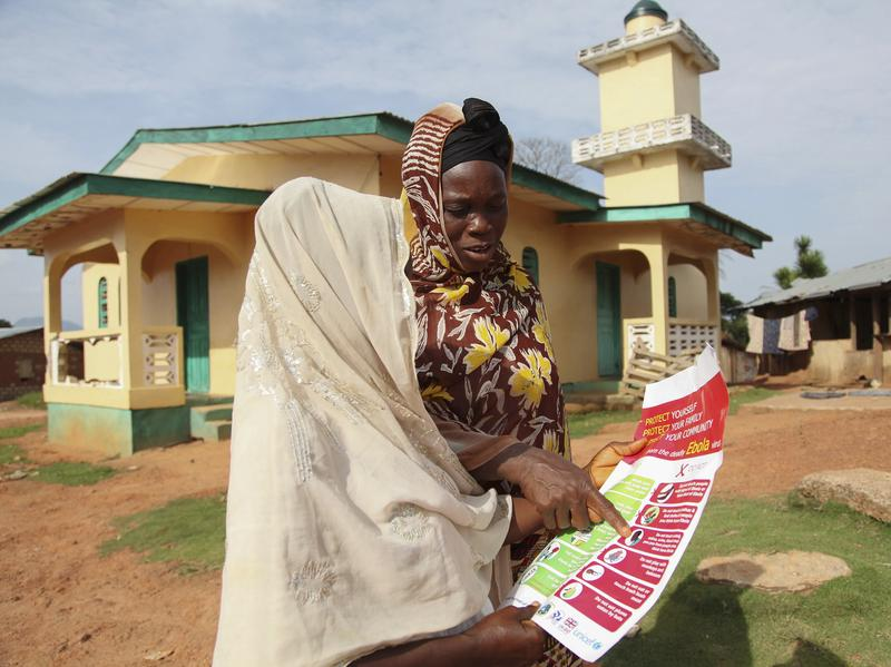 Lack of awareness about Ebola has fueled the outbreak in West Africa. Here, two Liberian women in Lofa read a pamphlet about how to prevent the spread of the virus.