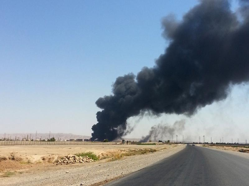 In this photo taken on June 19, 2014, a column of smoke rises from an oil refinery in Beiji, some 155 miles north of Baghdad, Iraq. There are reports today of more fighting at Beiji. (AP Photo)