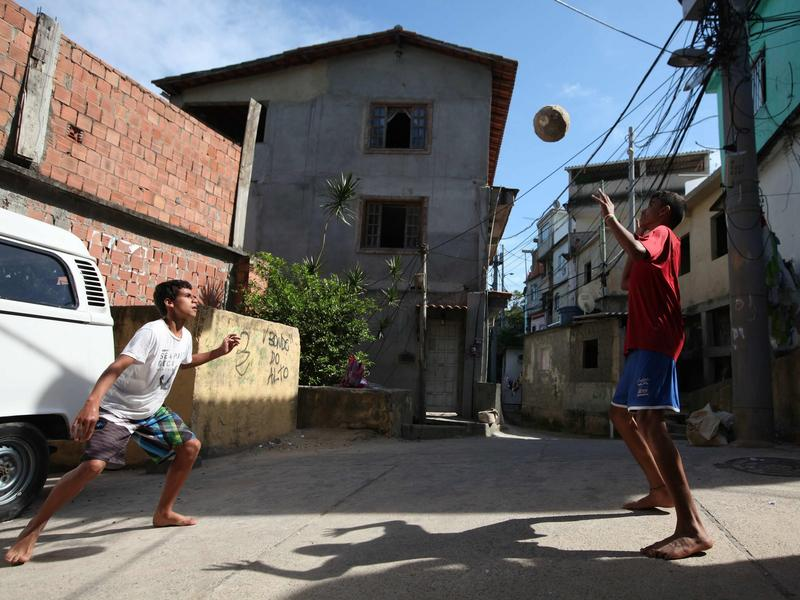 Two young men play street soccer in the Rio de Janeiro shantytown of Vidigal on May 14.