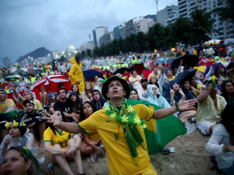 Brazil fans in Rio de Janeiro watch in horror as Germany routs the home team in the World Cup semifinal match played Tuesday.