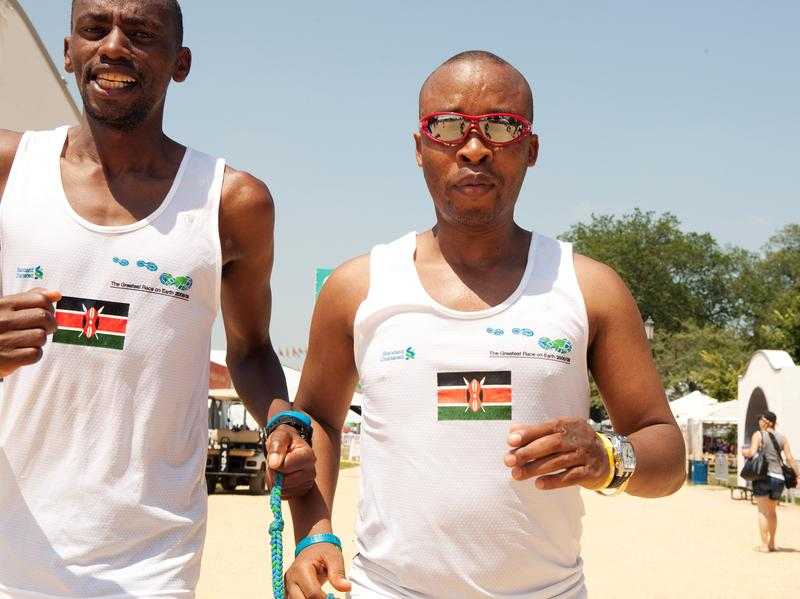 Joseph Kibunja guides blind runner Henry Wanyoike (in sunglasses).