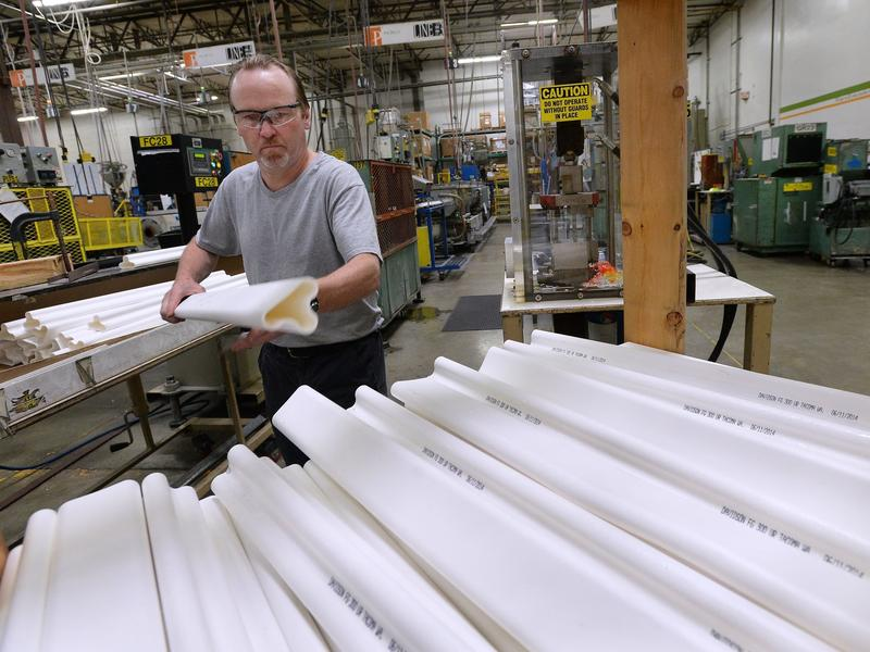 A worker stacks traffic safety poles at Pexco's manufacturing center in Fife, Wash. The small company ships products all over the world, with the help of federal insurance from the Export-Import Bank.