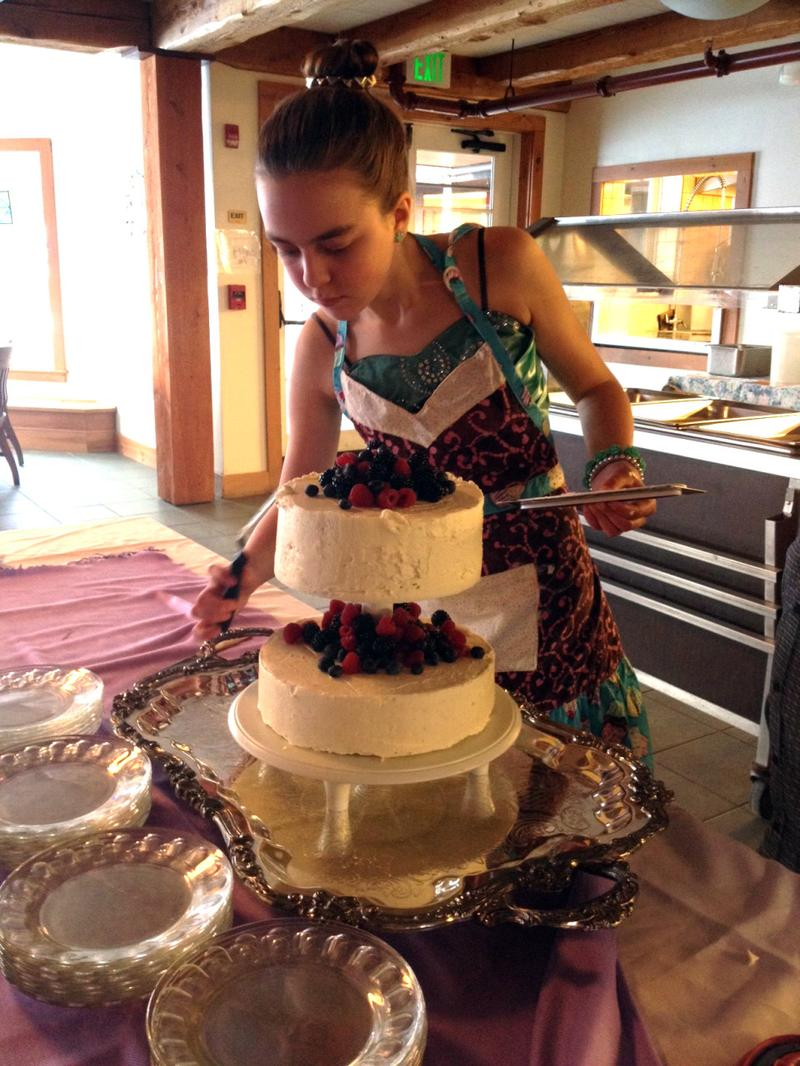 Imogen Von Mertens puts the finishing touches on the wedding cake. (Tod Von Mertens)