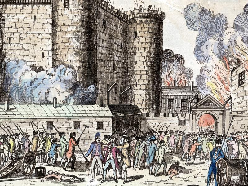 Citizens of Paris, headed by the National Guards, storm the Bastille prison in an event which has come to be seen as the start of the French Revolution, 14th July 1789.