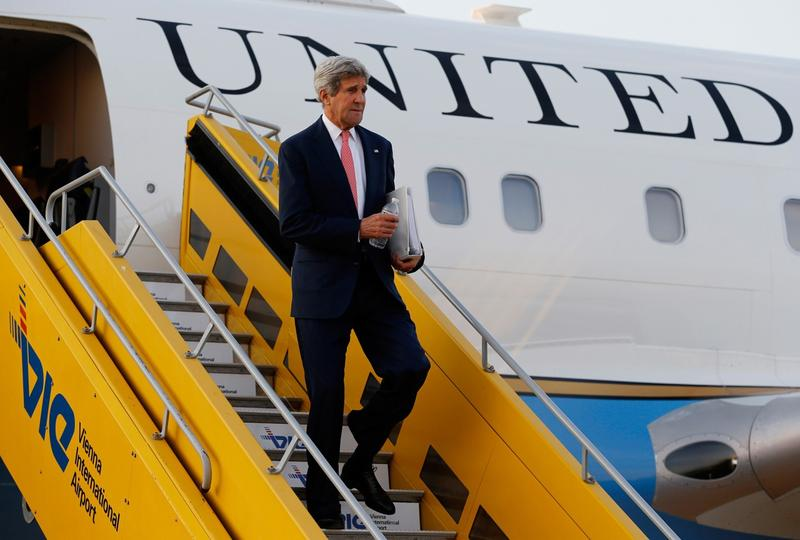 U.S. Secretary of State John Kerry disembarks from his plane after arriving at Vienna International Airport on July 13, 2014. Kerry landed in Austria early on July 13 to help steer the final stretches of negotiations between global powers and Iran over Tehran's suspect nuclear program, as a deadline for a deal looms. (Jim Bourg/AFP/Getty Images)