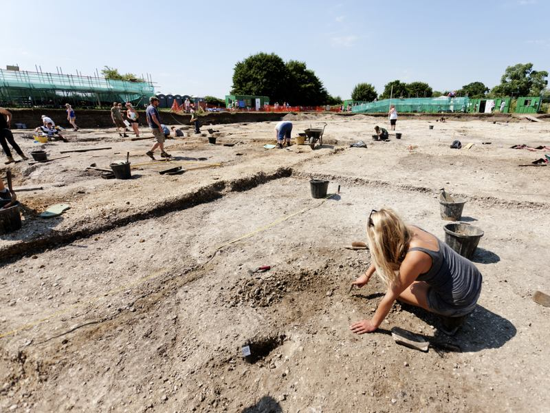 Students work at an archaeological dig near Silchester, England.