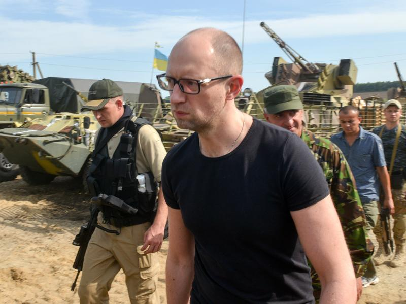 Ukrainian Prime Minister Arseniy Yatsenyuk visits forces stationed near the small city of Izyum on Wednesday.