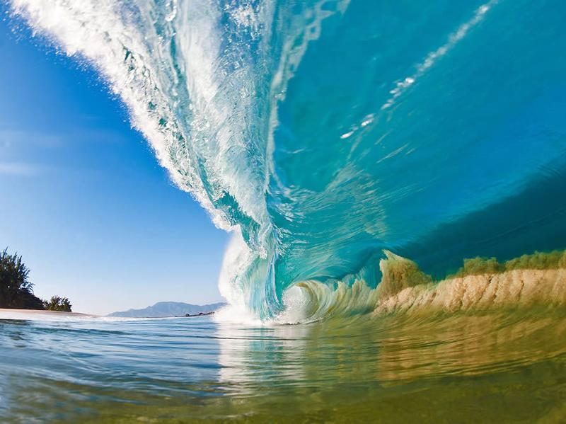 "A large wave on the North Shore of Oahu, Hawaii, sucks sand off of the seafloor and into the wave itself. This photo is the cover image of Clark Little's <a href=""http://www.clarklittlephotography.com/book.php"">latest coffee table book</a>, <em>Shorebreak</em>."