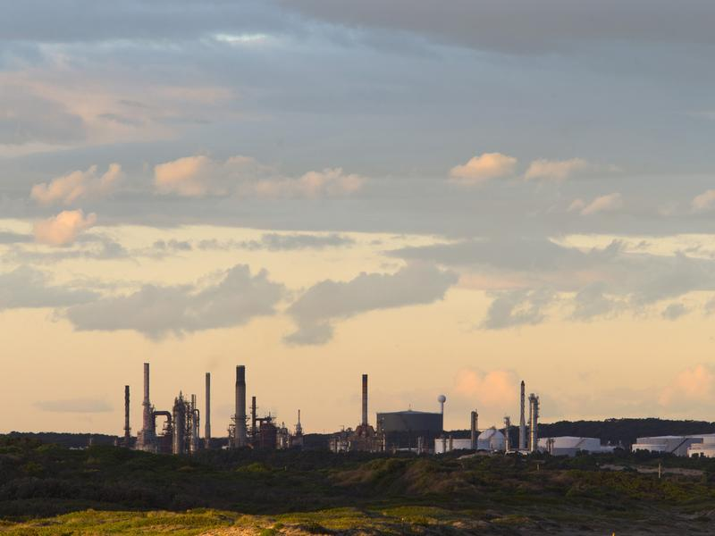 An oil refinery is pictured in the southern Sydney suburb of Kurnell earlier this week. Australia's Senate voted on Thursday to scrap the country's carbon tax and plans for emissions trading — a major victory for conservative Prime Minister Tony Abbott.