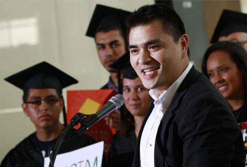 In this June 20, 2012, file photo former Washington Post journalist turned immigration reform activist, Jose Antonio Vargas, center, an illegal immigrant himself, speaks in Washington. (Jacquelyn Martin/AP)