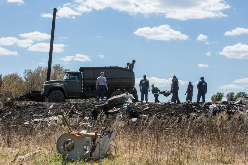 Personnel from the Ukrainian Emergencies Ministry load the bodies of victims of Malaysia Airlines flight MH17 into a truck at the crash site on July 21, 2014 in Grabovo, Ukraine. Malaysia Airlines flight MH17 was travelling from Amsterdam to Kuala Lumpur when it crashed killing all 298 on board including 80 children. The aircraft was allegedly shot down by a missile and investigations continue over the perpetrators of the attack. (Brendan Hoffman/Getty Images)